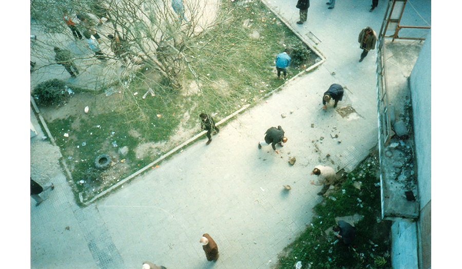 People break off stones from the pavement to use as ammunition. Photo: Robert Nagle, 1997 (CC BY-SA 2.0)