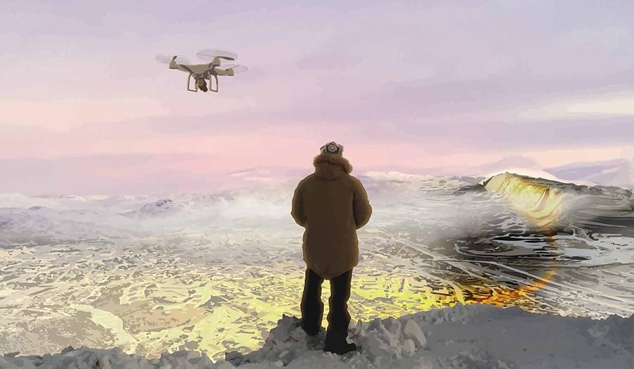 Man in winter clothing controlling a drone at edge of icy lake