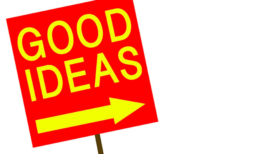 red angled sign on a post with yellow text saying good ideas and an arrow pointing right