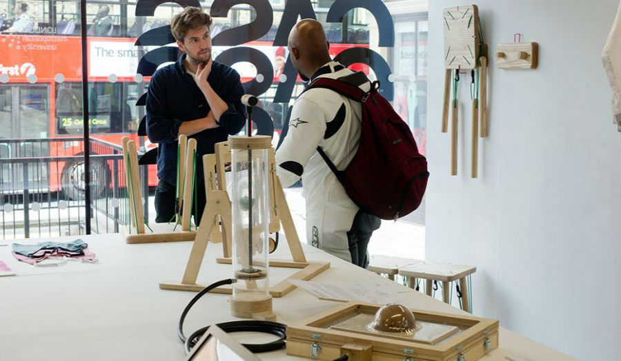 Two students in conversation in a School of Design setting at The Cass.