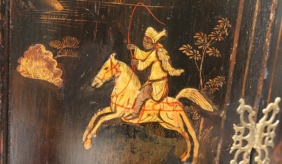 Gilded art work of a man on a horse