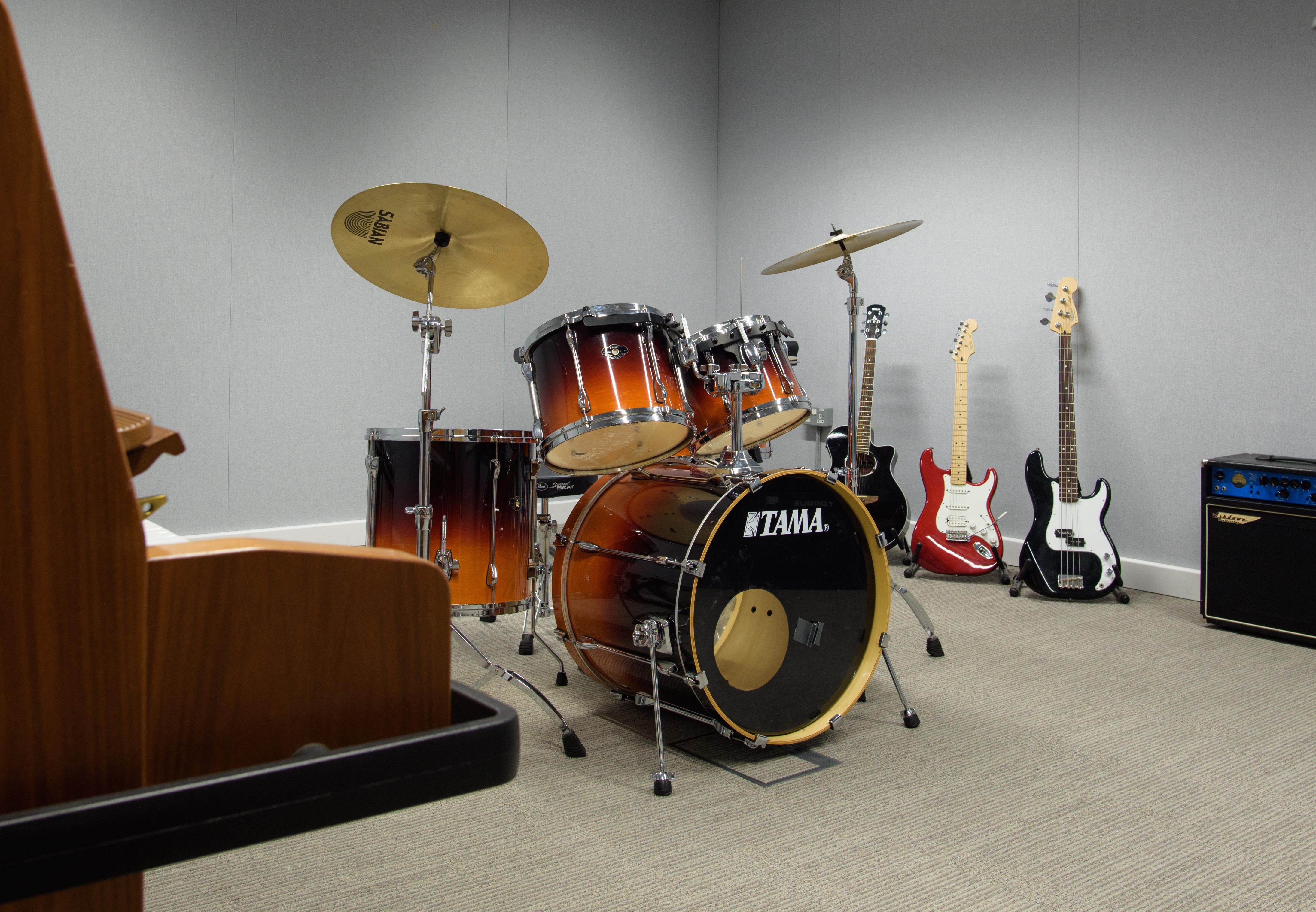 A drum set in the middle of a room