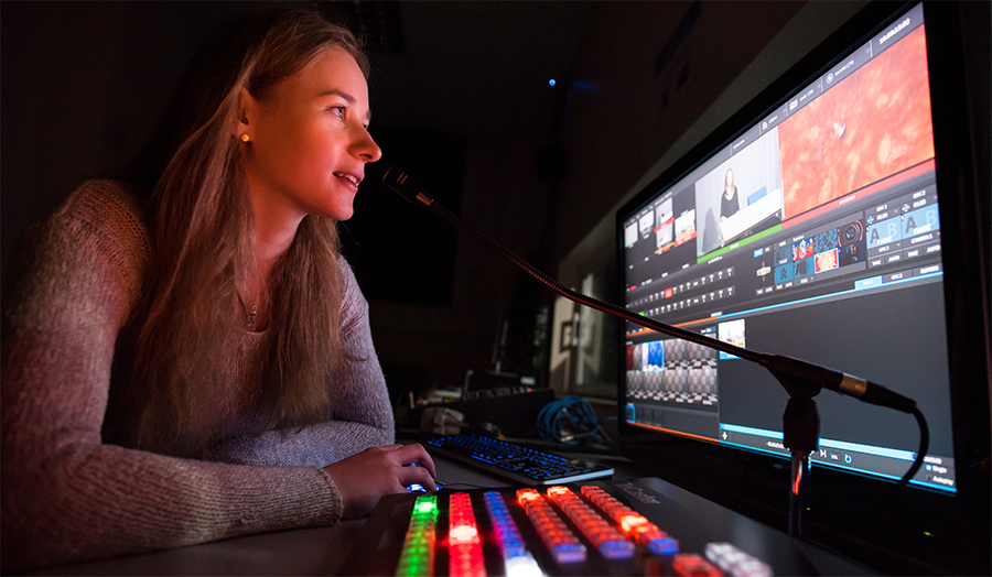 Female student using the TV studio's TriCaster