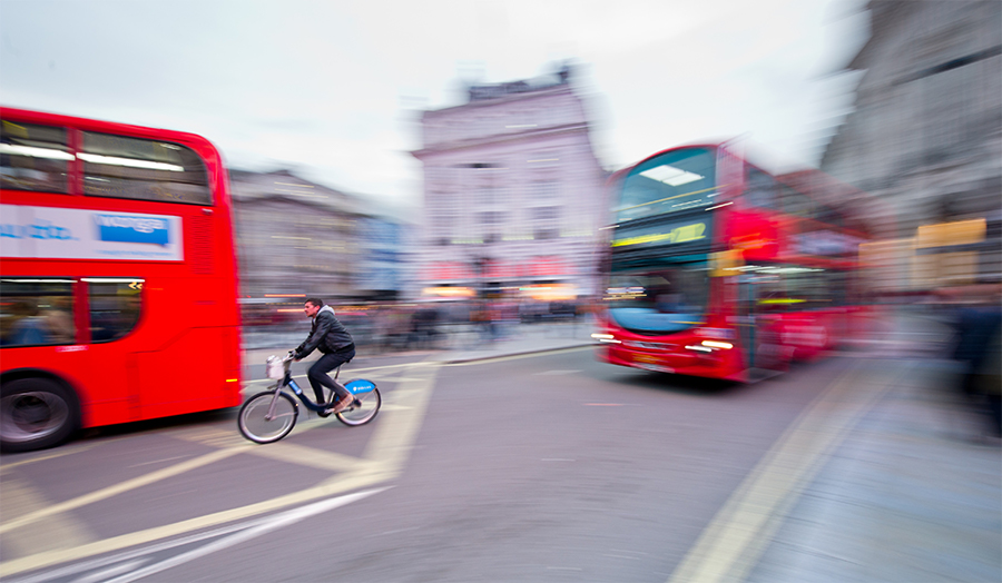 London buses and a cyclist