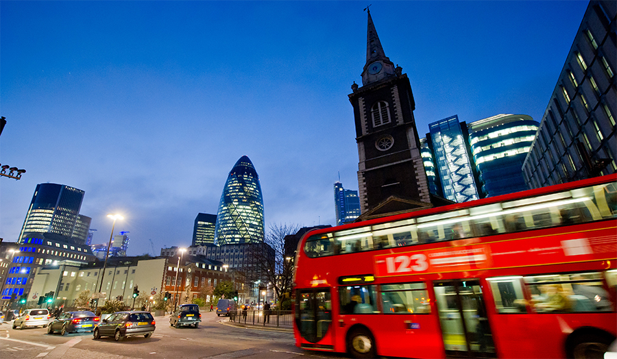 A view of the Gherkin with a London bus in the foreground