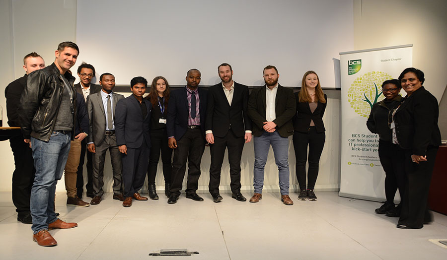 Photograph of students and speakers from the event.