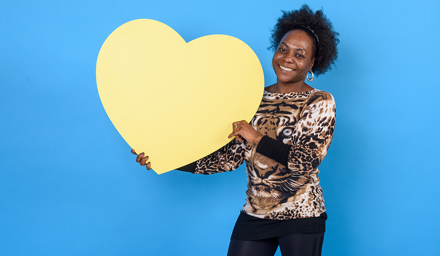 Student against a blue background with a heart