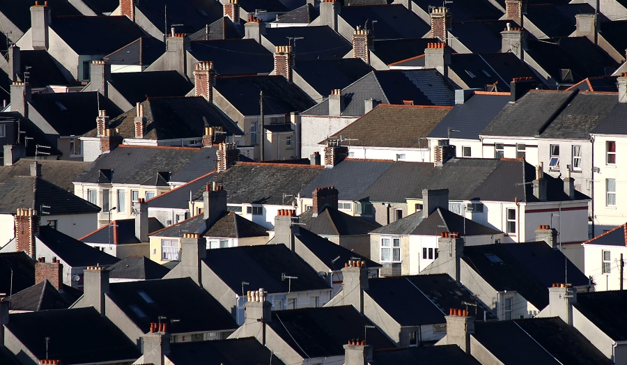 striking landscape shot of large housing estate with lots of rooftops and chimneys
