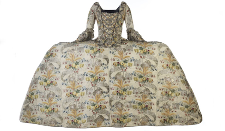 traditional old looking huguenot dress with wide shape and floral pattern