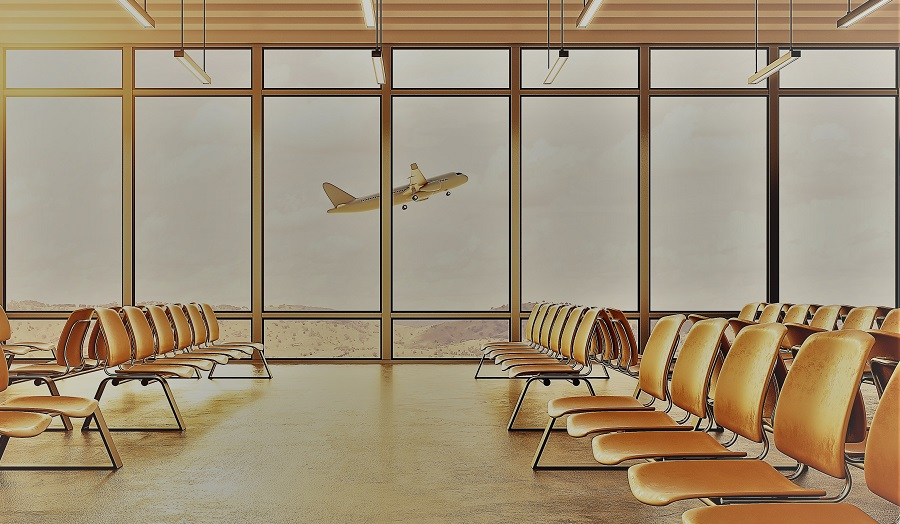 An airport waiting lounge, with a plane viewed through the windows