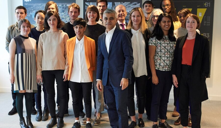 Group of people surround mayor of London Sadiq khan