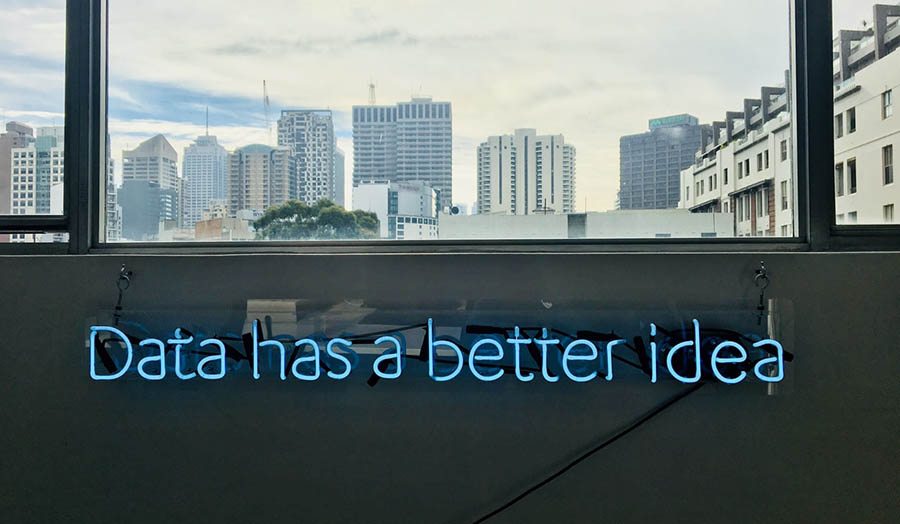 Neon sign on a wall saying 'Data Has a Better Idea'