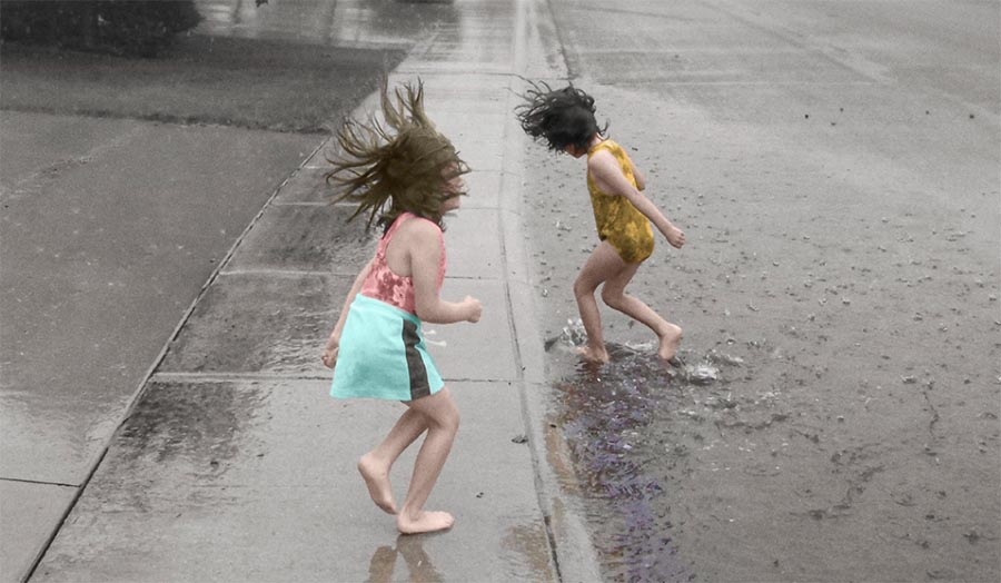 Two young children playing in the street - promotion shot for the show.
