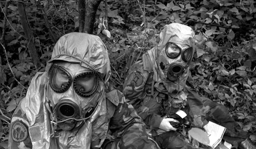 two people wearing gas masks