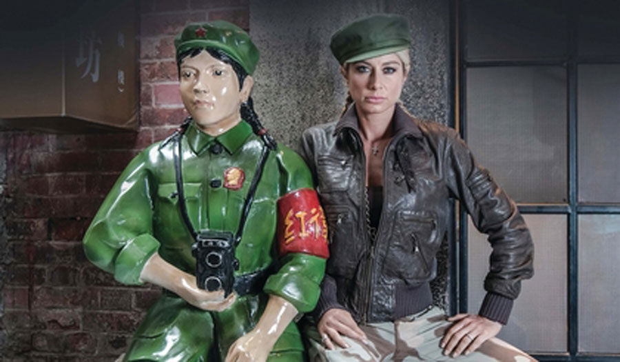 two women in chinese military clothing, one traditional, one modern