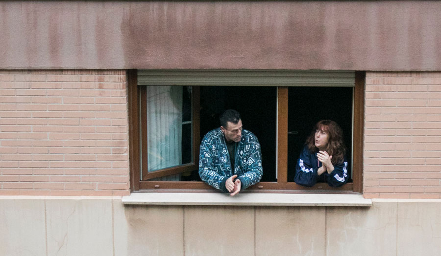 two people at flat window