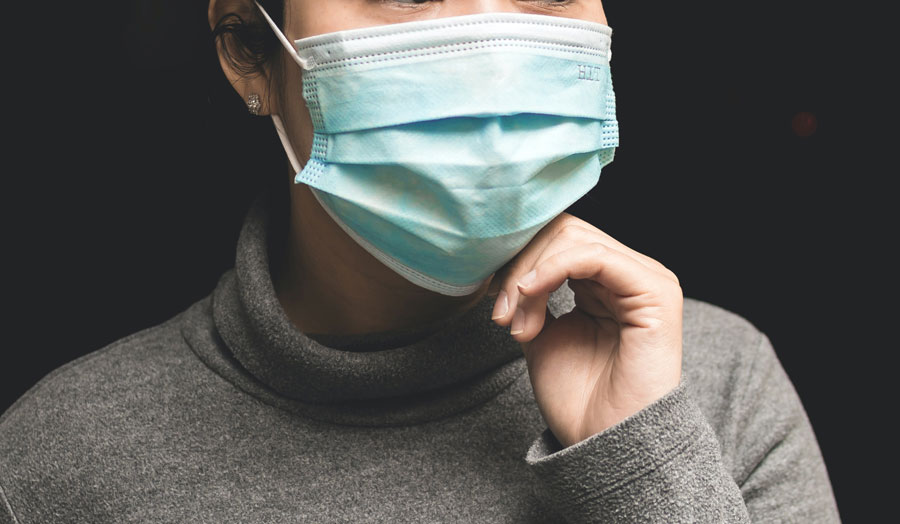 woman wearing a medical mask