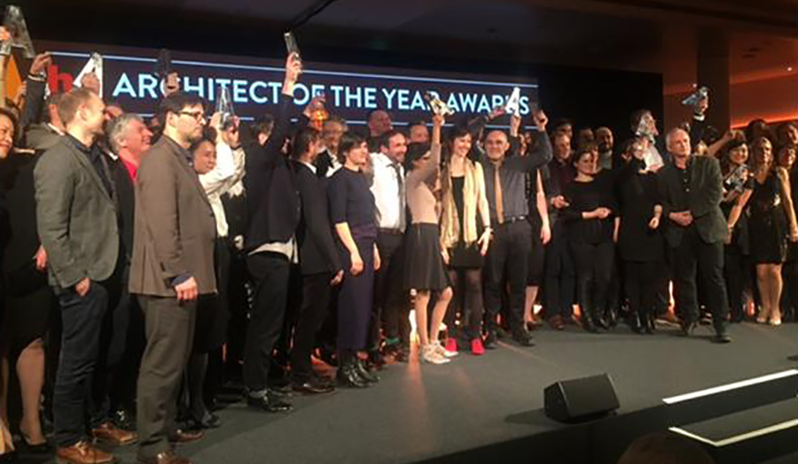 Winners raise their awards at the Architect of the Year Awards