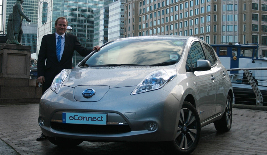 Head of eConnect Cars stands next to a nissan leaf