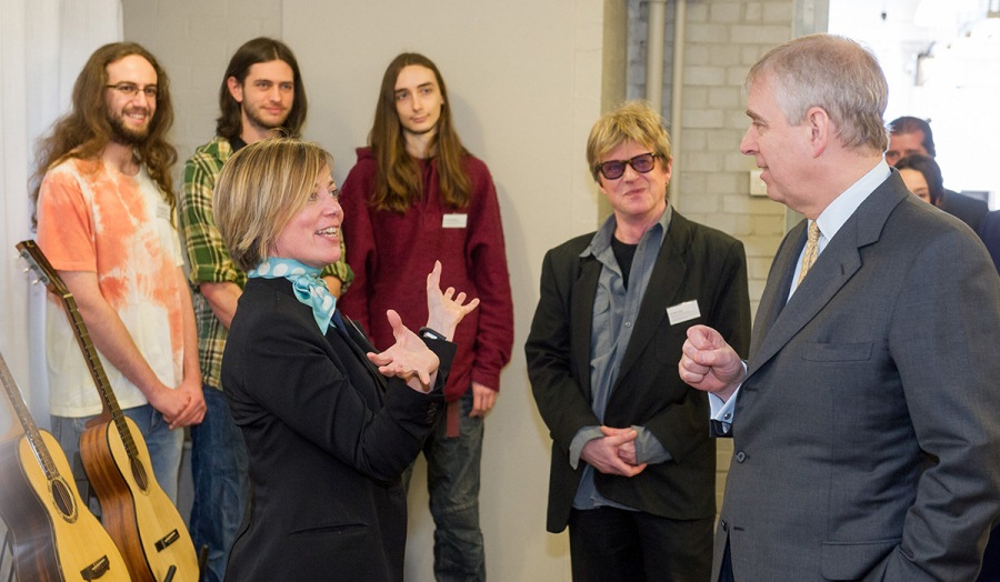 HRH The Duke of York meets three long haired students with two tutors and three guitars