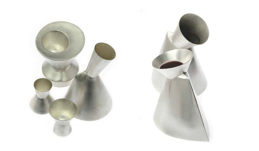 still life images of six abstract shaped silver vases and vessels
