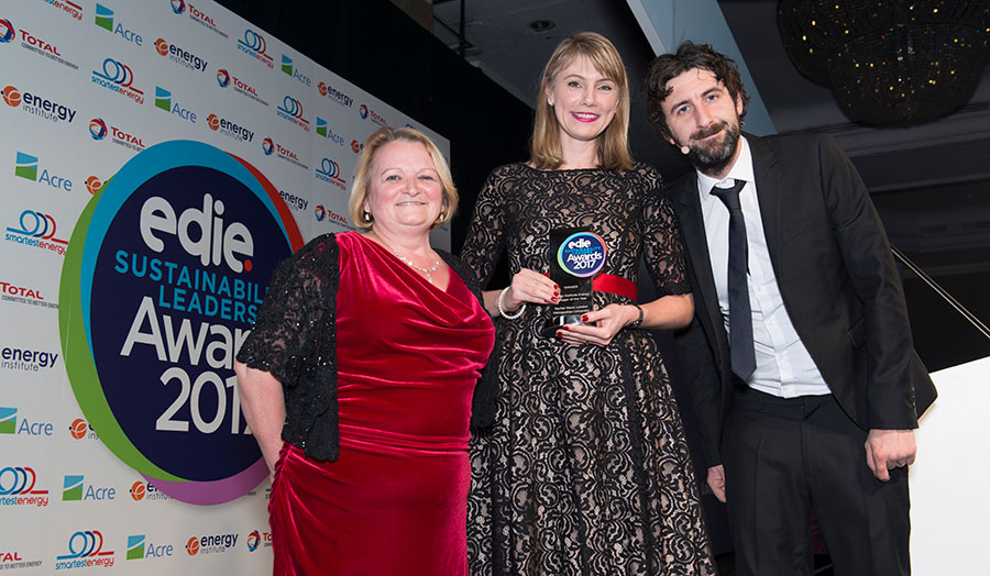 Image of Rachel collecting her award with capability director Sarah Beacock and compere Mark Watson