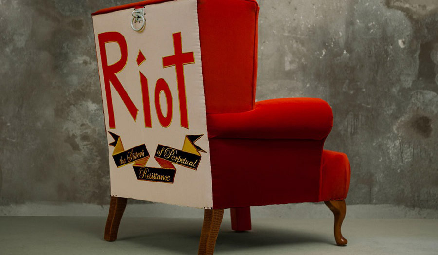 A red chair with a placard saying