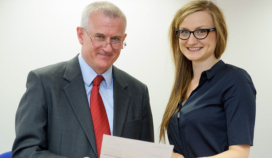 Marta received her prize from the Vice-Chancellor, Professor Malcolm Gillies