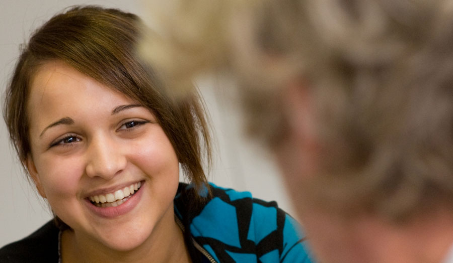 A close-up of a female student smiling