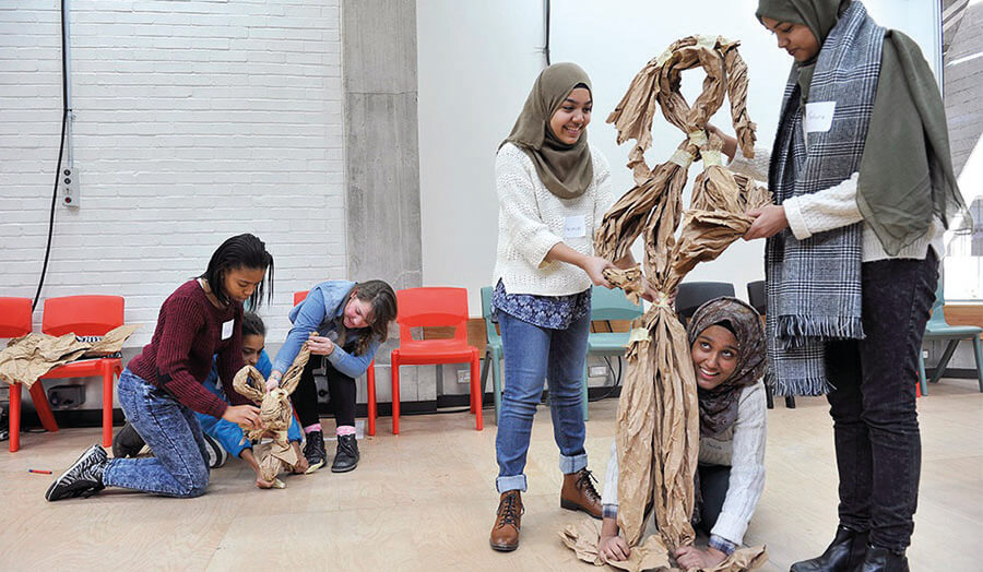 Students making puppets