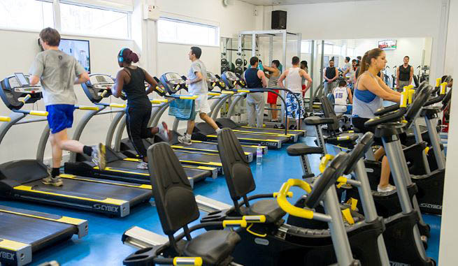 London Met gym members running on treadmills