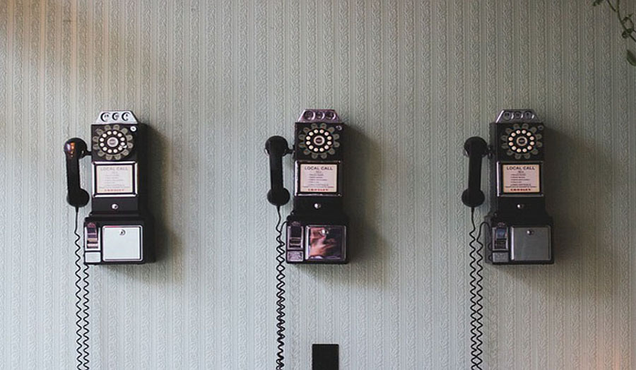 Old fashioned telephones mounted on a wall