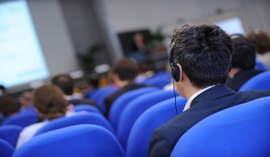 Man in conference with headphones for translation