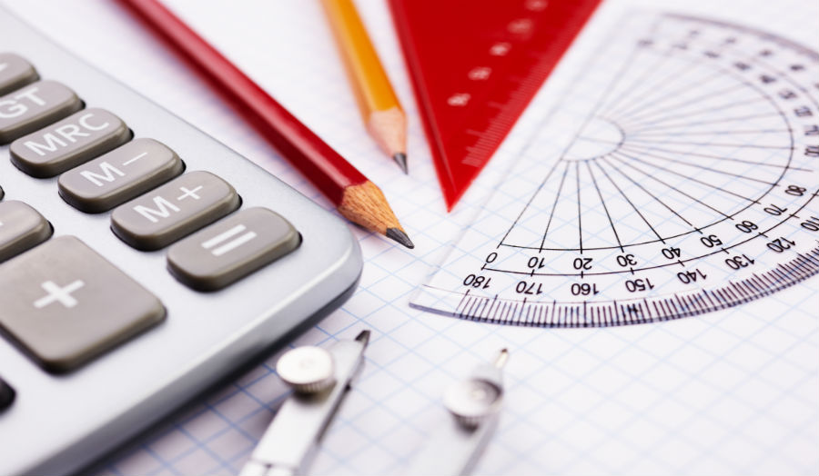 Picture of calculator, pencil and geometry measures.