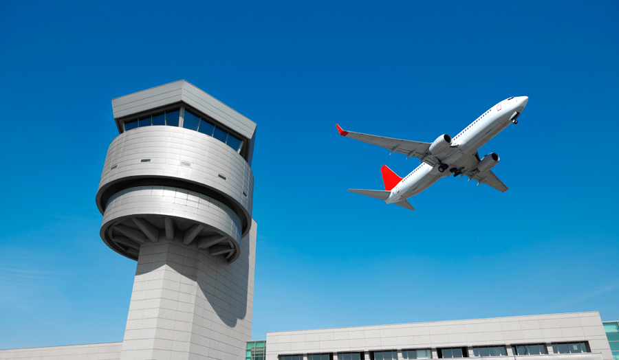 Plane and control tower stock image