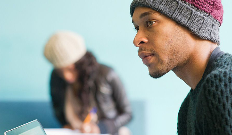 Black male student in hat