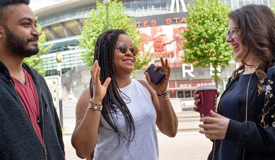 Students socialising by the Emirates Stadium