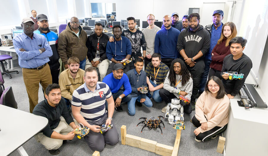 Group of students with their robots