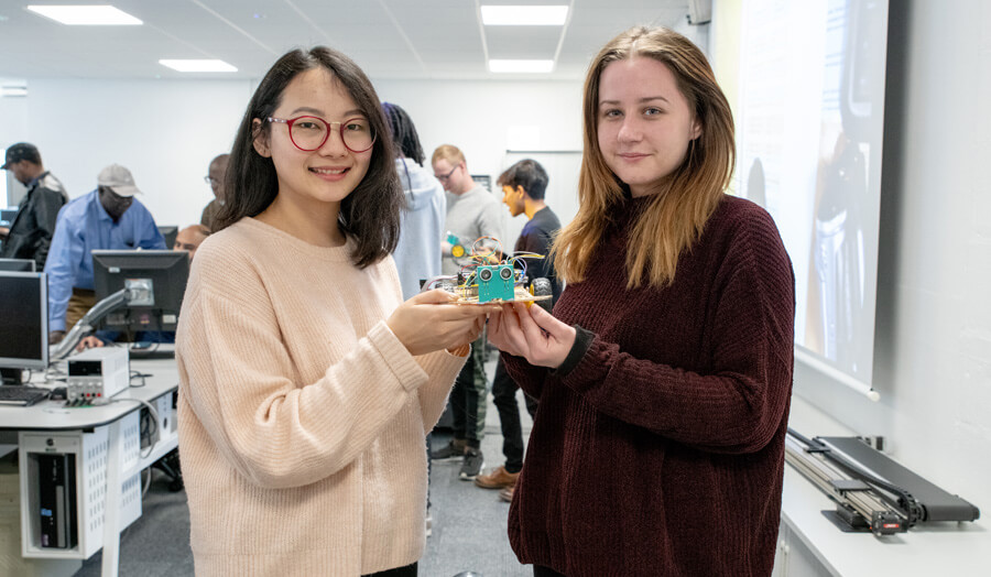 Pair of female students with their robots