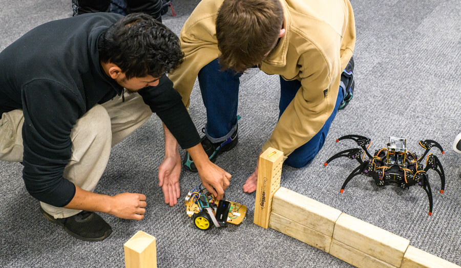 Students placing their robots in the maze
