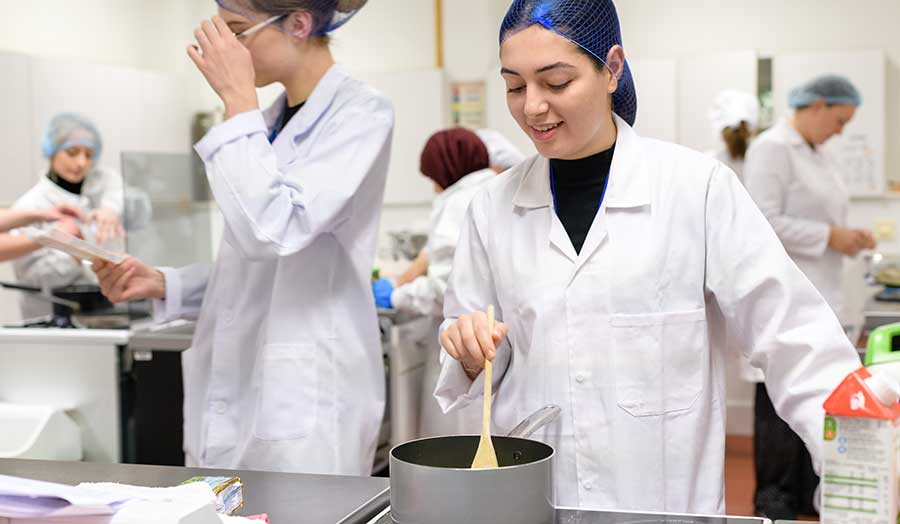 a female student stirring her cooking