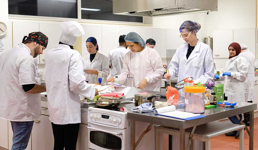 students in the professional kitchen
