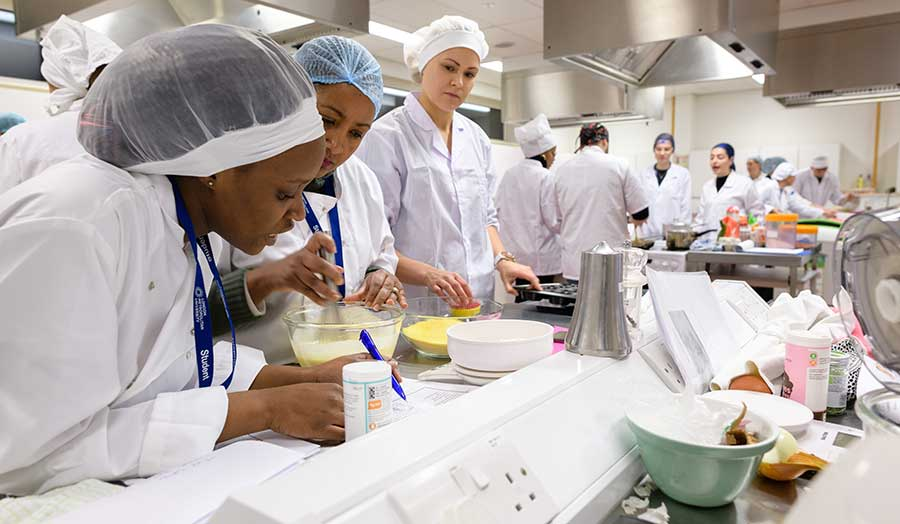 students recording their work during a practical kitchen project