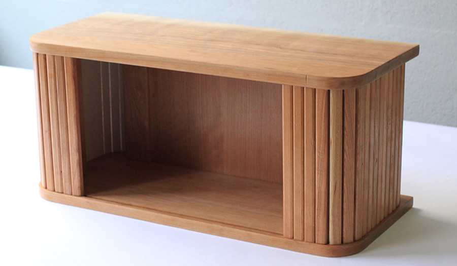 Wooden cabinet designed by a Cass student